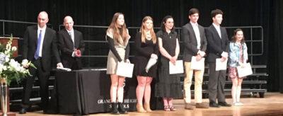 Scholarship Program winners on stage